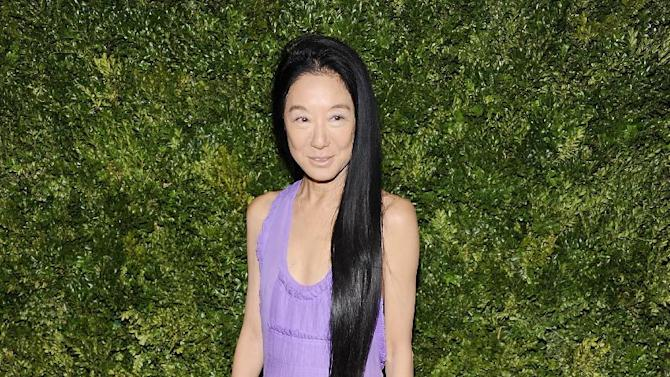 """FILE - This Nov. 14, 2011 file photo shows fashion designer Vera Wang attending the CFDA / Vogue Fashion Fund Awards in New York. Wang, who launched her label with wedding gowns, is separating from her husband Arthur Becker. A statement was issued to Women's Wear Daily earlier this week from company president Mario Grauso that said Wang and Becker """"mutually and amicably agreed to separate.""""  The couple married in 1989, when she still worked for Ralph Lauren. They have two daughters.  (AP Photo/Evan Agostini, file)"""