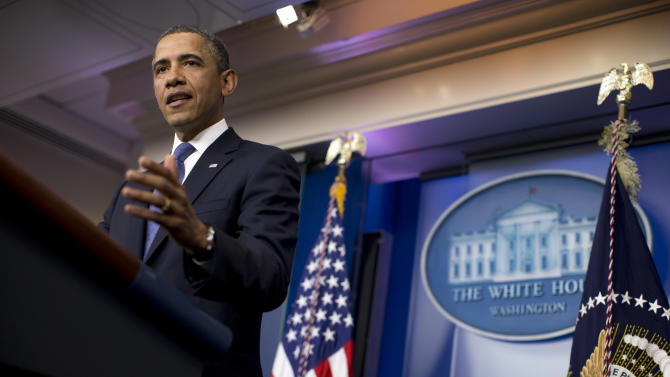 President Barack Obama gestures during a statement on the fiscal cliff negotiations with congressional leaders in the briefing room of the White House on Friday, Dec. 28, 2012 in Washington.  The negotiations are a last ditch effort to avoid across-the-board first of the year tax increases and deep spending cuts.  (AP Photo/ Evan Vucci)