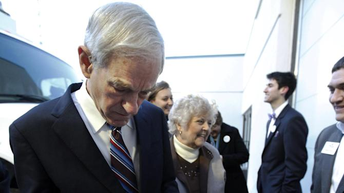 Republican presidential candidate Rep. Ron Paul, R-Texas, signs a campaign poster for supporters before he addresses a crowd at the North Dakota caucus Tuesday, March 6, 2012, in Fargo, N.D. (AP Photo/Charles Rex Arbogast)
