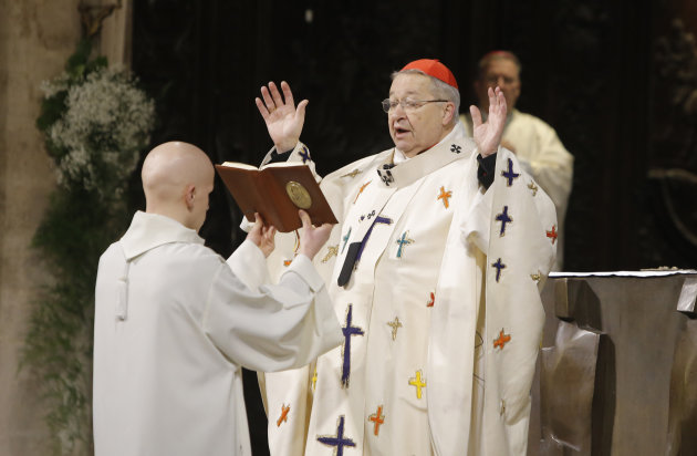 Paris Archbishop Andre Vingt-Trois celebrates mass during a ceremony of blessing for the nine new bronze bells in Notre Dame cathedral in Paris, Saturday, Feb. 1, 2013. Nine enormous new bronze bells 