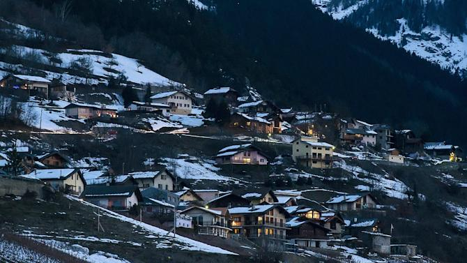 A view of the village of Daillon after a shooting, in Switzerland, early Thursday, Jan. 3, 2013. A man shot and killed three people and wounded another two in a Swiss village, and was then arrested by officers who shot and injured him, police said Thursday. Police in the southern canton (state) of Valais said they were alerted to the shooting in the village of Daillon just before 9 p.m. (20:00GMT) Wednesday. Three of the victims died at the scene and the two injured people were taken to hospitals. A police statement early Thursday gave no detail on their injuries. (AP Photos/Keystone, Olivier Maire)