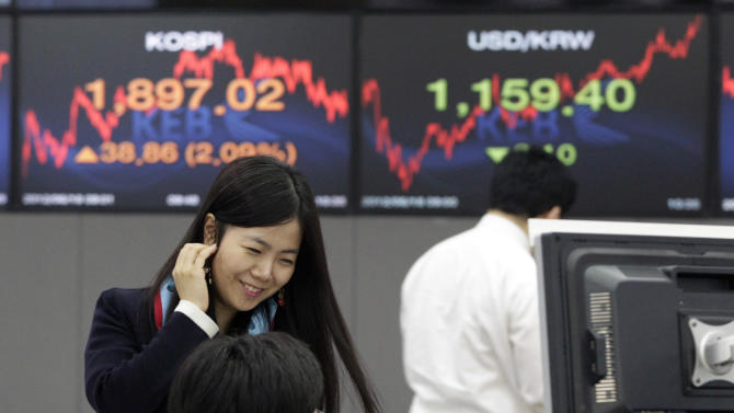 A currency trader reacts during a morning session at the foreign exchange dealing room of the Korea Exchange Bank headquarters in Seoul, South Korea, Monday, June 18,  2012. Asian stock markets climbed Monday after elections in Greece eased fears of global financial turmoil, but analysts warned that the economic crisis shaking the 17 nations in the euro common currency was far from over. South Korea's Kospi rose 2.1 percent at 1,897.83. (AP Photo/Ahn Young-joon)