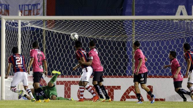 Marecos of Cerro Porteno scores a goal against Azcona of Independiente del Valle during their Copa Sudamericana soccer match at the Defensores del Chaco stadium in Asuncion
