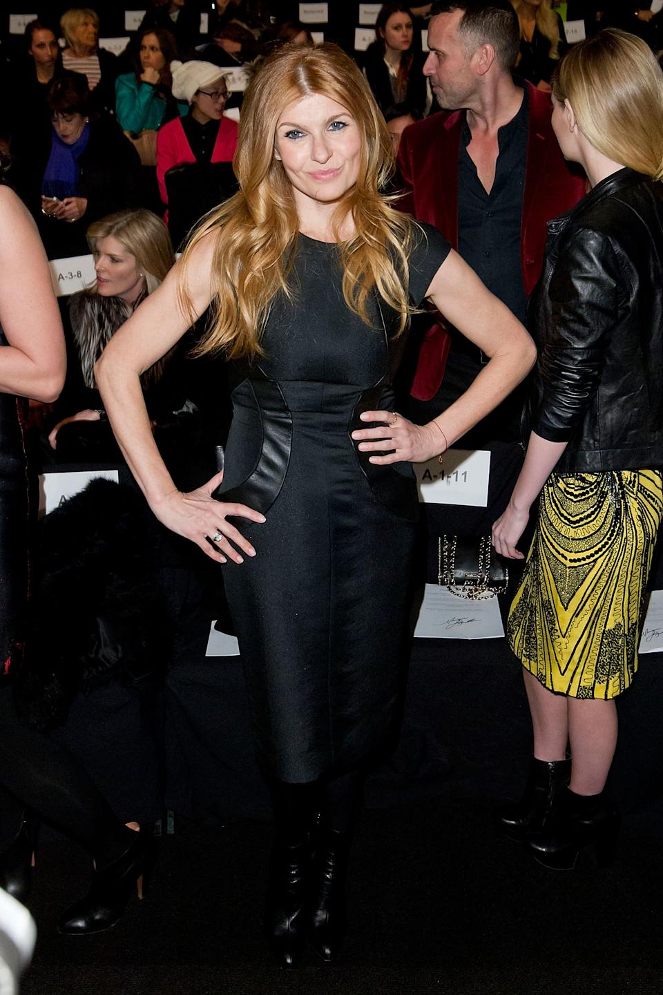 Actress Connie Britton attends the Fall 2013 Monique Lhuillier Runway Show, on Saturday, Feb., 9, 2013 in New York. (Photo by Ben Hider/Invision/AP)