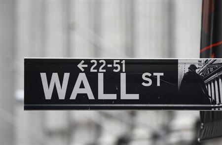 A Wall Street sign is seen in front of the exterior of the New York Stock Exchange