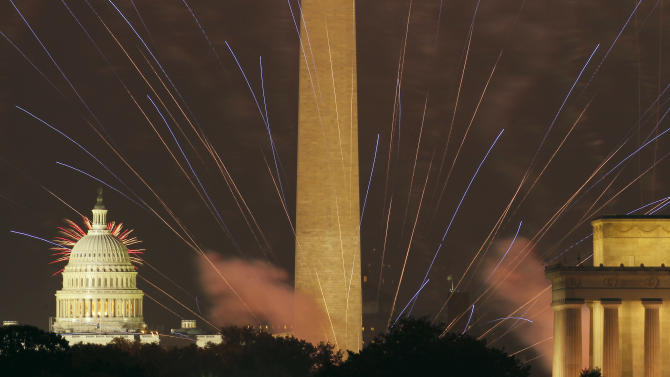 Fireworks light the sky over the U.S. Capitol, left, Washington Monument and Lincoln Memorial in Washington on Wednesday, July 4, 2012, as seen from Arlington, Va. (AP Photo/Alex Brandon)