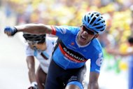 Great Britain&#39;s David Millar reacts after crossing the finish line ahead of France&#39;s Jean-Christophe Peraud at the end of the twelfth stage of the 2012 Tour de France cycling race starting in Saint-Jean-de-Maurienne and finishing in Annonay Davezieux, southeastern France. Millar won the longest stage of the Tour de France after dominating a two-up sprint with Peraud