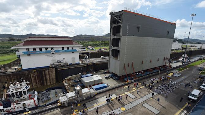The last gate to be used on a new set of locks on the Panama Canal arrives in Panama City, on December 10, 2014