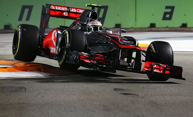 SINGAPORE - SEPTEMBER 22:  Lewis Hamilton of Great Britain and McLaren drives during qualifying for the Singapore Formula One Grand Prix at the Marina Bay Street Circuit on September 22, 2012 in Singapore, Singapore.  (Photo by Robert Cianflone/Getty Images)