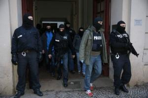 German special police units leave an apartment building…
