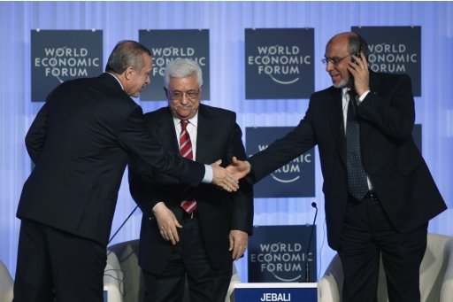 Turkish Prime Minister Erdogan shakes hands with Tunisia's Prime Minister Jebali as Palestinian President Abbas looks on during World Economic Forum in Istanbul