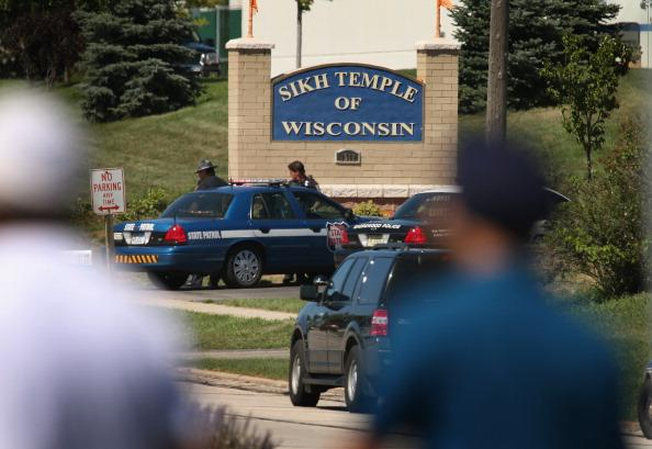 Police guard the front of the Sikh Temple of Wisconsin where at least one gunman fired upon people at a service August, 5, 2012 Oak Creek, Wisconsin. At least six people were killed when a shooter, who was later shot dead by a police officer, opened fire on congregants in the Milwaukee suburb. (Photo by Scott Olson/Getty Images)