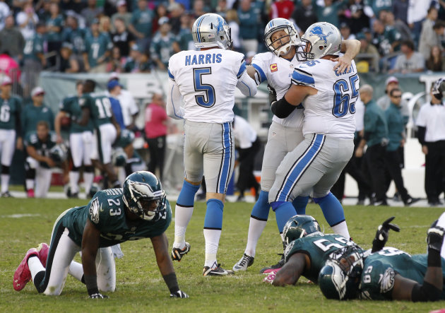 Detroit Lions kicker Jason Hanson, center, is congratulated by Dylan Gandy (65) and Nick Harris (5) after kicking a 45-yard field goal to give the Lions a 26-23 overtime victory over the Philadelphia Eagles in an NFL football game, Sunday, Oct. 14, 2012, in Philadelphia. (AP Photo/Mel Evans)