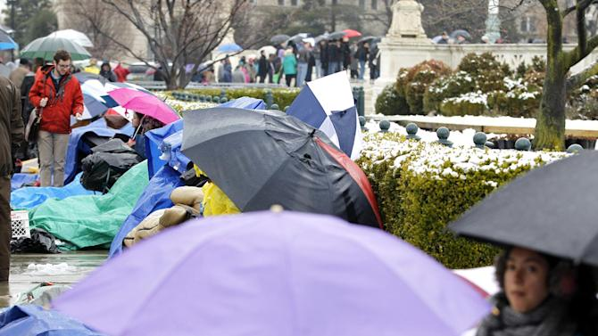 People wait in line outside of the Supreme Court in Washington, Monday March, 25, 2013, a day before the court will hear a same-sex marriage case. (AP Photo/Jose Luis Magana)