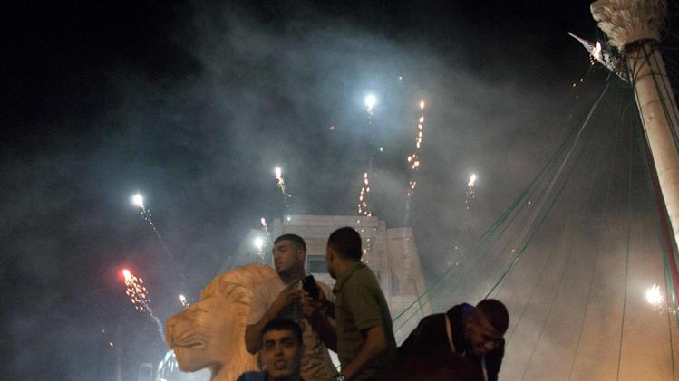 "Palestinians launch fireworks during celebrations in the West bank city of Ramallah, late Sunday, July 20, 2014. The Hamas' armed wing said it has captured an Israeli soldier during fighting in the Gaza Strip. Speaking on a Hamas television station, spokesman Abu Ubaida said ""we have captured a Zionist soldier and the occupation has not admitted that."" The claim could not immediately be verified and the Israeli military said it was investigating the report. (AP Photo/Nasser Nasser)"