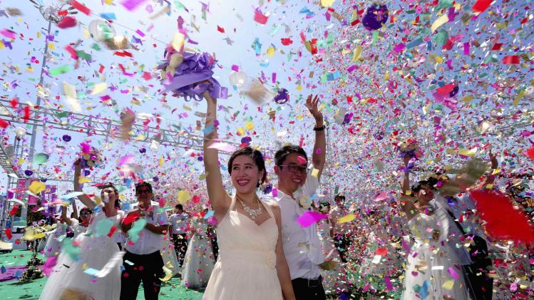 Couples celebrate during a mass wedding ceremony to mark the Qixi Festival in Shenyang