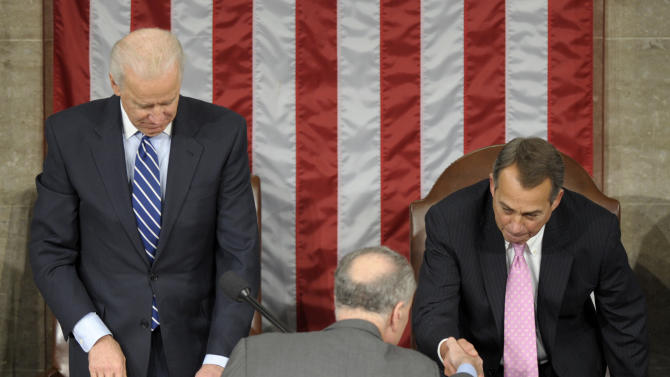 Vice President Joe Biden watches at left as Sen. Charles Schumer, D-N.Y., center, shakes hands with House Speaker John Boehner of Ohio, right, in the House Chamber during the counting of Electoral College votes on Capitol Hill in Washington, Friday, Jan. 4, 2013. Biden presided over a Joint Session of Congress Friday as four members of the House and Senate took turns announcing the votes that had been tallied in state capitals last month affirming the re-election of Barack Obama as President of the United States. (AP Photo/Susan Walsh)