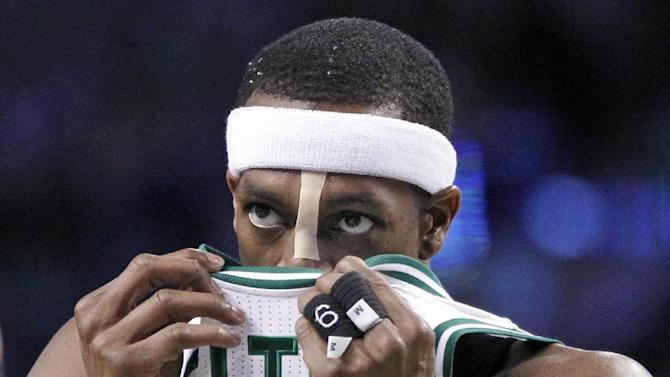 Boston Celtics guard Rajon Rondo (9) wipes his face with his jersey in the second half of an NBA basketball game against the Toronto Raptors in Boston, Wednesday, March 26, 2014