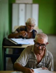 Roma people attend a class in a school of Berkovitsa in August 2012. Bulgaria's Roma community makes up 10 percent of the population. The vast majority live in poverty and unemployment is rampant