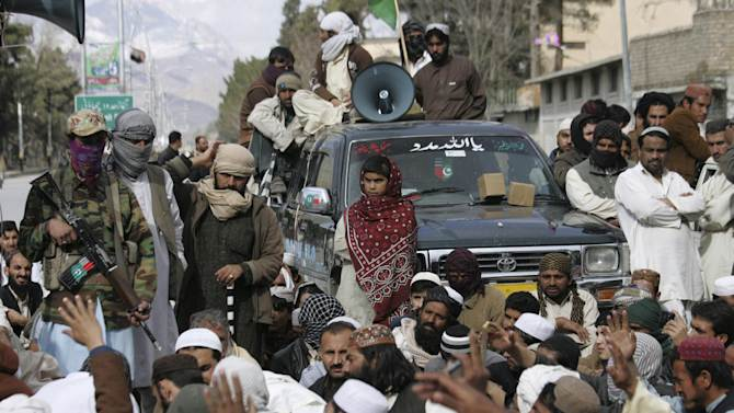 "In this Friday, Feb. 22, 2013, photo, supporters of Pakistani Sunni group, Ahle Sunnat Wal Jamaat attend a rally to condemn killings of their party activists by allegedly security forces, in Quetta, Pakistan. Pakistan's minority Shiite Muslims have begun to use words like ""genocide"" to describe a violent spike in attacks directed against them by a militant Sunni group, with suspicious links to the country's security agencies and a mainstream political party that governs the largest province, where some of the most violent jihadi groups are headquartered. (AP Photo/Arshad Butt)"