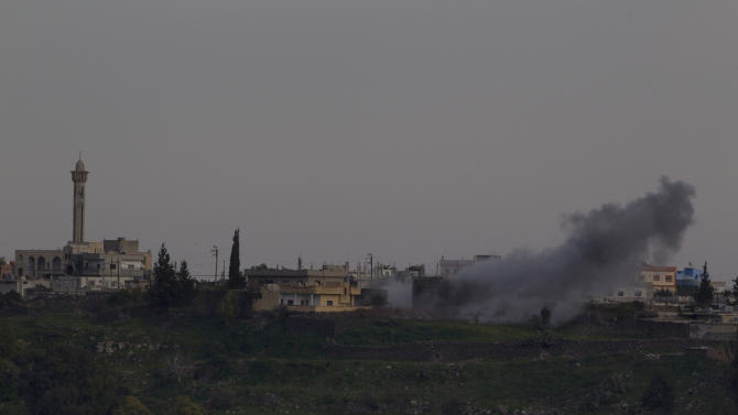Smoke rises following an explosion in the  Syrian village of Jamlah in the southern province of Daraa, Syria, as seen from the Israeli-controlled Golan Heights ,Thursday, March 7, 2013. Clashes between Syrian troops and rebel fighters flared on Thursday near an area where armed fighters linked to the opposition abducted 21 U.N. peacekeepers a day earlier. The peacekeepers are part of a force that monitors a cease-fire between Israeli and Syrian troops in the Golan Heights. Israel captured part of the territory in the 1967 Mideast war, and while the area has been peaceful for decades, Israeli officials have grown increasingly jittery as the Syrian civil war moves closer to its borders. (AP Photo/Ariel Schalit)