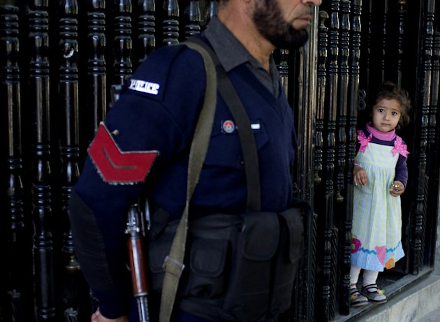 In this Thursday, Oct. 18, 2012 photo, A Pakistani police officer stands guard outside the school of Pakistani shooting victim Malala Yousufzai, in Mingora, Swat Valley, Pakistan. The Talibans horrific attack on a female teenage activist in this scenic corner of Pakistans northwest was the latest in a series of assassination attempts by militant sleeper cells in the area over the last year. The insurgents activated their networks in the Swat Valley to take advantage of the armys decision to reduce its presence, raising questions about the military&#39;s ability to hand over control to civilian authorities in areas where it has fought the Taliban, a fundamental part of its counterterror strategy. (AP Photo/B.K. Bangash)