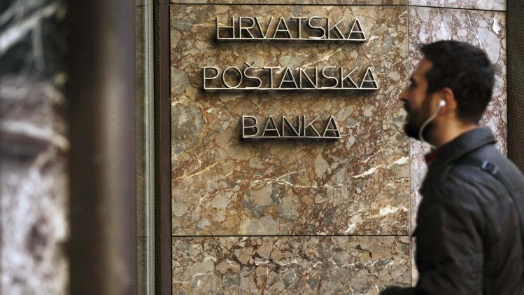 Man walks past Croatian state-owned bank Hrvatska Postanska Banka in Zagreb