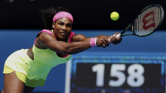 Williams of the U.S. stretches to hit a return to Muguruza of Spain during their women's singles fourth round match at the Australian Open 2015 tennis tournament in Melbourne