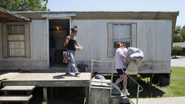 Leah Cortez, left, and her friend Casey Provolt move Cortez's belongings out of Cortez's trailer in Krotz Springs, La., Sunday, May 15, 2011, as they evacuate in advance of forecasted flooding brought on by the opening of the Morganza Spillway north of Butte LaRose. (AP Photo/Patrick Semansky)