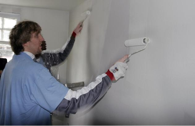 In this Feb. 15, 2008 file photo, Dallas Mavericks basketball star Dirk Nowitzki, of Germany, paints a wall in a home in the Lower 9th ward of New Orleans. This week marks six years since NBA All-Star
