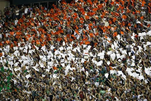 Fluminense's fans cheer before a Copa Libertadores soccer match between Brazil's Fluminense and Paraguay's Olimpia in Rio de Janeiro, Brazil,  Wednesday, May 22, 2013