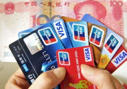 "<p>This file illustration photo shows a handful of credit cards and a 100 yuan banknote. Beijing said on Tuesday it had ""reservations"" over a WTO ruling largely backing the United States in a dispute over lucrative electronic payments, in which US companies are global leaders but lag in China.</p>"