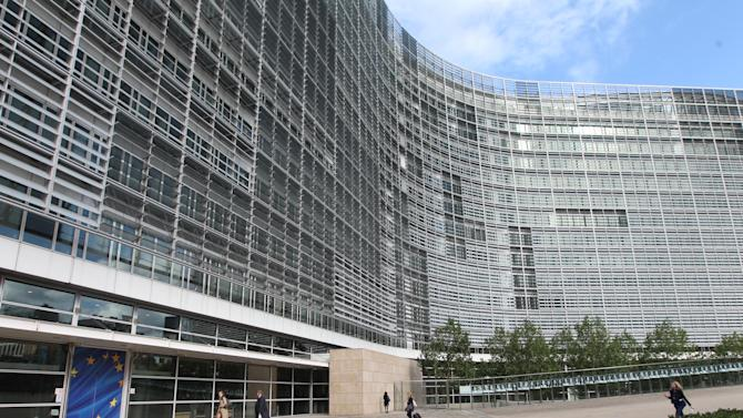 People walk along the European Commission headquarters, after the 2012 Nobel Peace Prize was awarded to the EU, at the European Commission headquarters in Brussels, Friday, Oct. 12, 2012. The European Union won the Nobel Peace Prize on Friday for its efforts to promote peace and democracy in Europe, despite being in the midst of its biggest crisis since the bloc was created in the 1950s. (AP Photo/Yves Logghe)
