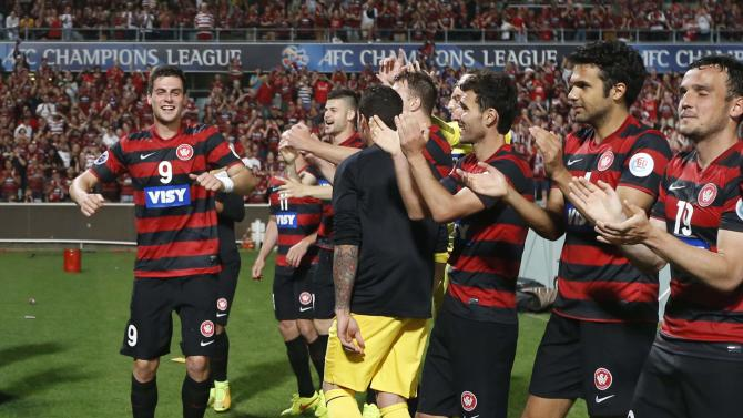 Western Sydney Wanderers' Juric dances alongside his team in a celebration following their Asian Champions League final first-leg soccer match victory against Al Hilal at in Sydney