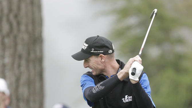 Jim Furyk reacts to a shot out of the rough on the 12th hole during the fourth round of the U.S. Open Championship golf tournament Sunday, June 17, 2012, at The Olympic Club in San Francisco. (AP Photo/Eric Gay)