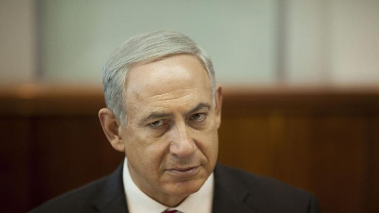 Israeli Prime Minister Benjamin Netanyahu attends the weekly cabinet meeting in Jerusalem Sunday, Oct. 13, 2013. (AP Photo/Ariel Schalit, Pool)