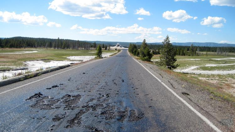 This undated photo provided by the National Park Service shows damage to a Yellowstone National Park road caused by the park's ever-changing thermal features in the park in Wyoming. The hot, damaged pavement has prompted park officials to close Firehole Lake Drive and access to some geysers and thermal features at the height of summer tourist season. (AP Photo/Yellowstone National Park)
