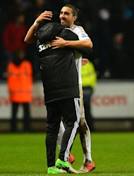 Swansea City's Spanish defender Chico Flores (R) celebrates at the final whistle of the League Cup semi-final second leg against Chelsea. Swansea beat the European Champions over two legs to reach the final against Bradford City