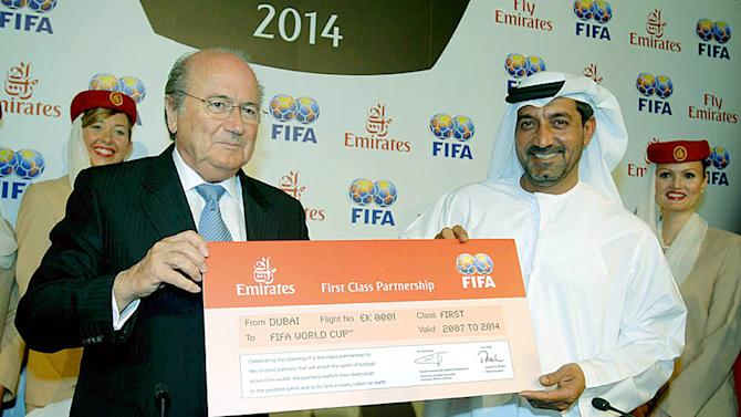 FILE - In this Tuesday April 18, 2006 file picture released by Emirates News Agency, Emirates Chairman, Sheik Ahmed bin Saeed Al-Maktoum, right, and FIFA President, Sepp Blatter hold a mock ticket in Dubai after they signed a US$195 million deal to become a FIFA Partner from 2007 to 2014 . An Emirates executive said Friday Nov 23 2012 that the airline will assess the extent of FIFA's anti-corruption reforms and the public reaction before renewing its sponsorship with the organization. (AP Photo/WAM, File)