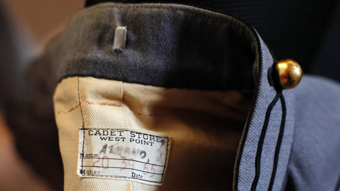 This Dec. 20, 2012 photo shows the label inside the military tunic originally worn by 1971 West Point graduate Joseph Francis Albano. When Mary Helen Taft picked up the jacket on consignment about 20 years ago, she had thought it was an elaborate costume. When the story of an 80-year-old military tunic found among Superstorm Sandy debris at the Jersey Shore made national headlines, Taft realized the item in her closet was not just a run-of-the-mill coat. (AP Photo/Genevieve Ross)