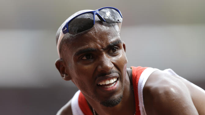 Britain's Mohamed Farah reacts after competing in a men's 5000-meter heat during the athletics in the Olympic Stadium at the 2012 Summer Olympics, London, Wednesday, Aug. 8, 2012. (AP Photo/Anja Niedringhaus)