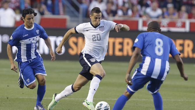 The United State's Geoff Cameron (20)  drives against Honduras' Roger Espinoza (15) and teammate Wilson Palacios (8) in the second half during an World Cup qualifying soccer match at Rio Tinto Stadium on Tuesday, June 18, 2013, in Sandy, Utah.  (AP Photo/Rick Bowmer)