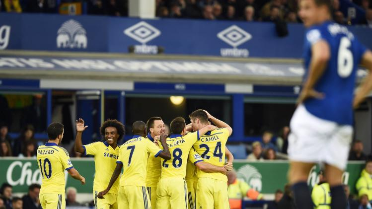 Chelsea's Matic celebrates with teammates after scoring a goal against Everton during their English Premier League soccer match at Goodison Park in Liverpool