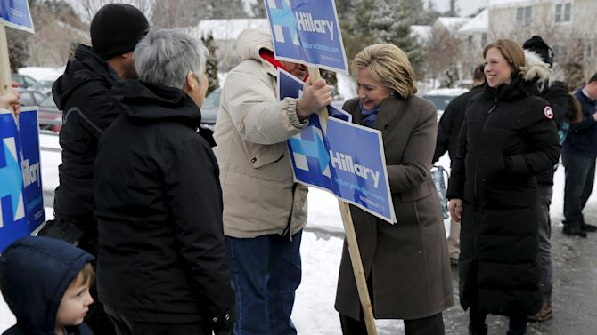 U.S. Democratic presidential candidate Hillary Clinton and her daughter Chelsea greet supporters outside a polling place in Derry