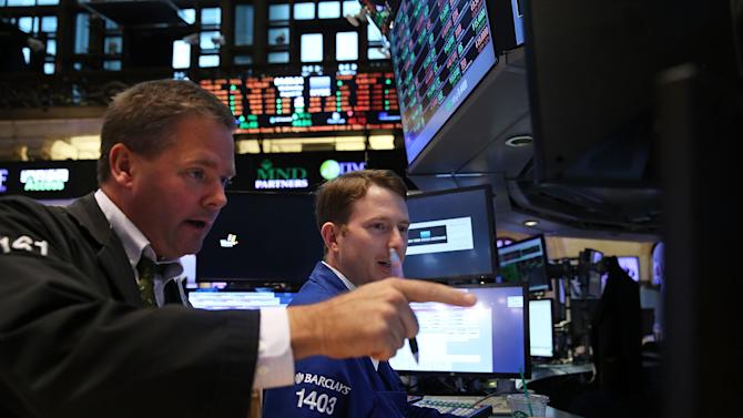 Traders work on the floor of the New York Stock Exchange on August 13, 2014 in New York