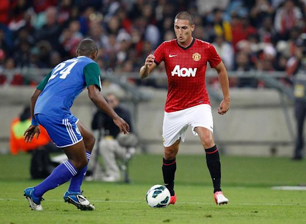Amazulu midfielder Ramson Zhuwawo tries to tackle Manchester United's Federico Macheda during their MTN Football Invitational match at the Moses-Mabhida Stadium in Durban on July 18, 2012