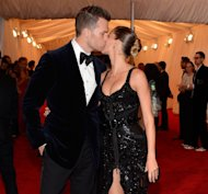 Tom Brady and Gisele Bundchen kiss at the 'Schiaparelli And Prada: Impossible Conversations' Costume Institute Gala at the Metropolitan Museum of Art in New York City on May 7, 2012 -- Getty Premium