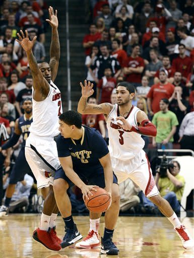 No. 12 Louisville holds off Pittsburgh 64-61