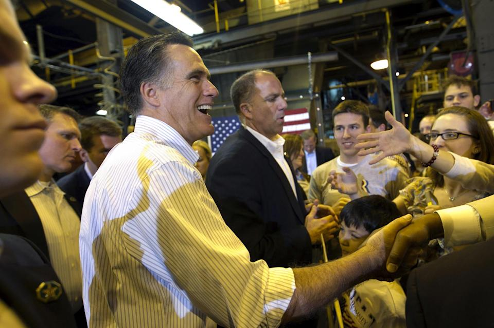 Republican presidential candidate, former Massachusetts Gov. Mitt Romney shakes hands with supporters at Charlotte Pipe and Foundry Company in Charlotte, N.C., Friday, May 11, 2012. (AP Photo/Jae C. Hong)