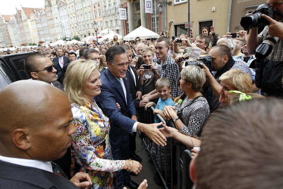 Republican presidential candidate, former Massachusetts Gov. Mitt Romney and wife Ann greet the crowd outside The Gdansk Old Town Hall, in Gdansk, Poland, Monday, July 30, 2012. (AP Photo/Charles Dharapak)